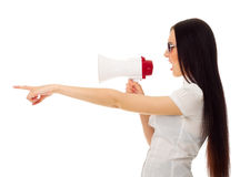 Girl with megaphone shows pointing gesture Royalty Free Stock Photography