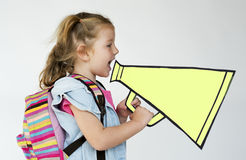 A girl with megaphone speaking Royalty Free Stock Photography