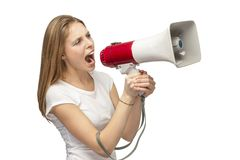 Girl with a megaphone. On white background beautiful girl with red megaphone Royalty Free Stock Image