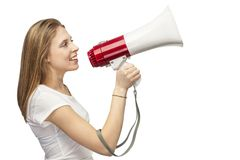 Girl with a megaphone. On white background beautiful girl with red megaphone Stock Image