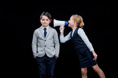 Girl with megaphone yelling on boy Stock Photos