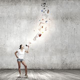 Girl with megaphone Royalty Free Stock Photo