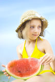 Girl with melon Royalty Free Stock Images