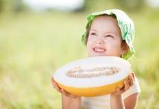 Girl with melon Stock Photos