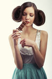 Girl melting chocolate on her lips Stock Images