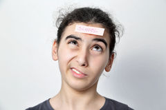 Girl with memo posts on her forehead. Little girl with memo posts on her forehead Stock Photography
