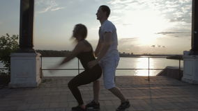 Girl and men dancing strip plastic at sunset stock footage video stock video