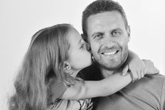 Girl and man with happy smiling face isolated on white background. Daughter and father hug each other. Schoolgirl kisses. Girl and men with happy smiling face Royalty Free Stock Photography