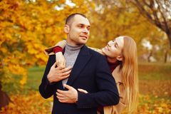 Girl and man or lovers on date hug. Couple in love in park . Autumn dating concept. Man and woman with happy faces royalty free stock photography