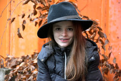 Girl with men`s hat. Perky  teenage girl with black men`s hat Stock Photo
