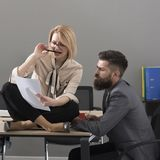 Girl and man write business plan. Girl and bearded man work together in office, collaboration for success Royalty Free Stock Photography