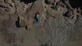 The girl in the mermaid costume Melasti beach Bali dron. The girl in the mermaid costume Bali island dron video Melasti Beach Ariel stock video