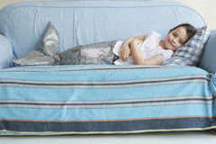 Girl In Mermaid Costume Lying On Sofa Royalty Free Stock Photo
