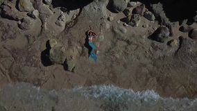The girl in the mermaid costume Melasti beach Bali dron. The girl in the mermaid costume Bali island dron video Melasti Beach Ariel stock video footage