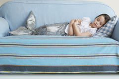 Girl In Mermaid Costume Sleeping On Sofa Royalty Free Stock Image