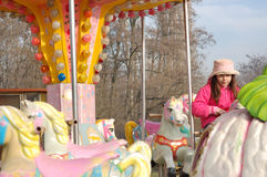 Girl on Merry Go Round Royalty Free Stock Photos