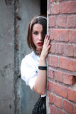 Girl with mesh on head and hand on the brickwall. Senzual style. Fashion shot. Royalty Free Stock Photos