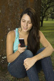 Girl messaging with cellphone Royalty Free Stock Photos