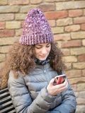 Girl messaging Stock Photography