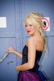 Girl at metal door Stock Images