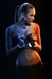 Girl in metal handcuffs Stock Image