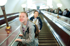 Girl in metro. A girl (11 years) lifts on a metro escalator Stock Photos