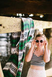 Girl with mexican blanket under pier Stock Photography