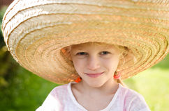 Girl in Mexican hat Royalty Free Stock Image