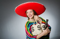 Girl in mexican poncho holding handgun and money Stock Photography