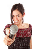 Girl with mic in white Royalty Free Stock Image