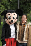 Girl with Mickey Mouse. Teen girl with Mickey Mouse,the festival dolls, St. Petersburg, Russia Royalty Free Stock Image