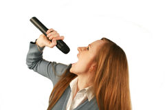 Girl with a microphone. The girl sings in a microphone Royalty Free Stock Photo