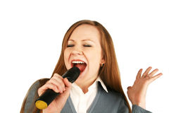 Girl with a microphone. The girl sings in a microphone Stock Image