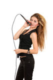 Girl with microphone Stock Photography