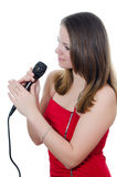 Girl with a microphone Royalty Free Stock Photos