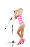 Girl with microphone Royalty Free Stock Photography