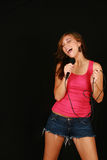 Girl with microphone Royalty Free Stock Photo