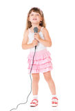 Girl with microphone Royalty Free Stock Photos