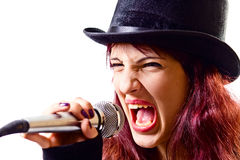 Girl with microphone in  black top-hat Royalty Free Stock Images