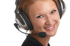 Girl with a microphone and headphones Royalty Free Stock Images