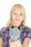 Girl with a microphone. Girl holding microphone in the camera Royalty Free Stock Image