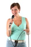 Girl with a microphone leading a show or singing Stock Photos