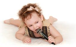 Girl with a microphone lies Royalty Free Stock Photos