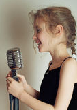 Girl with microphone. royalty free stock photos