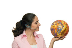 Girl with microphone and puzzle ball like globe Royalty Free Stock Photography