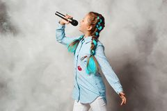 Girl with a microphone stock photography