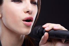 Girl with microphone Stock Photos