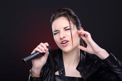 Girl with microphone Royalty Free Stock Images