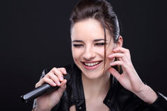 Girl with microphone Stock Photo