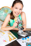 Girl microscope Royalty Free Stock Image